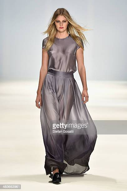 A model walks the runway in a design by Caslazur at the New Generation show during MercedesBenz Fashion Week Australia 2014 at Carriageworks on April...