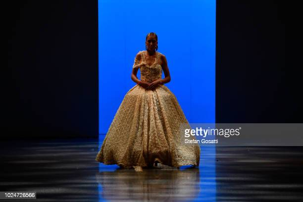 A model walks the runway in a design by Cecilia Kang Couture during the New Generation Emerging Couture show during New Zealand Fashion Week 2018 at...