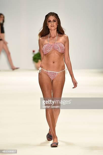 A model walks the runway in a design by Cleonie at Swim show during MercedesBenz Fashion Week Australia 2014 at Carriageworks on April 8 2014 in...