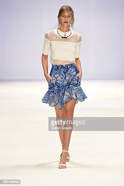 A model walks the runway in a design by Diyana Kosso at the Raffles show during MercedesBenz Fashion Week Australia 2014 at Carriageworks on April 9...