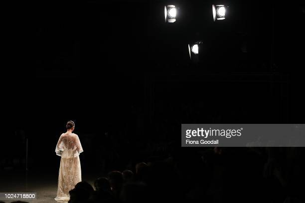 A model walks the runway in a design by during the New Generation Emerging Couture show during New Zealand Fashion Week 2018 at Viaduct Events...