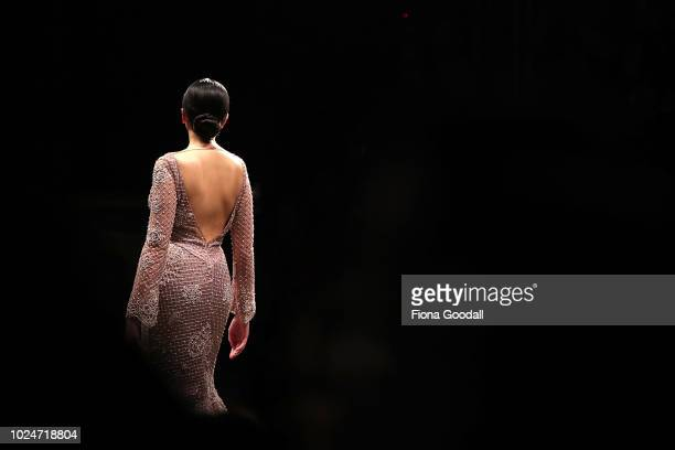 Model walks the runway in a design by during the New Generation Emerging Couture show during New Zealand Fashion Week 2018 at Viaduct Events Centreâ...