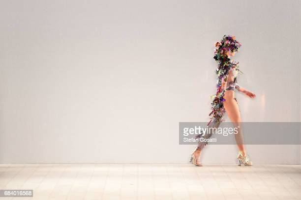 A model walks the runway in a design by EWOL during The Innovators Fashion Design Studio show at MercedesBenz Fashion Week Resort 18 Collections at...