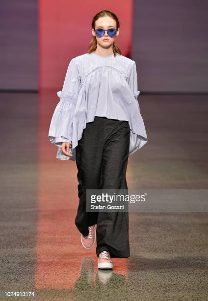 A model walks the runway in a design by Havilah during the New Generation show during New Zealand Fashion Week 2018 at Viaduct Events Centre on...