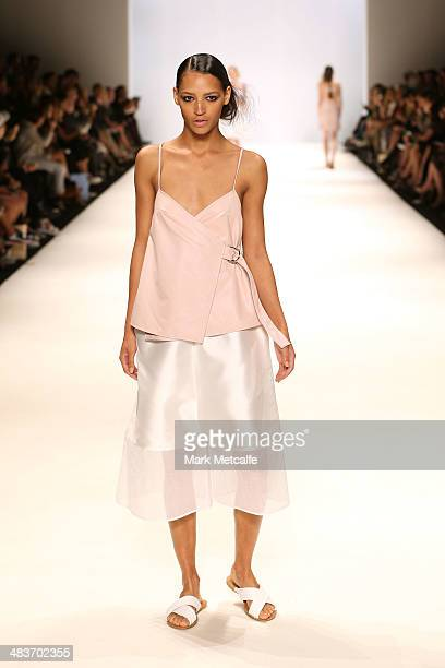 A model walks the runway in a design by Hayley Dawson at The Innovators show during MercedesBenz Fashion Week Australia 2014 at Carriageworks on...