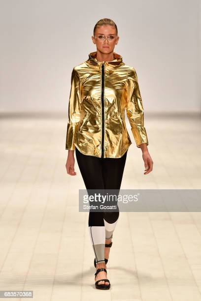 A model walks the runway in a design by HUNTRLND during the Active Collective show at MercedesBenz Fashion Week Resort 18 Collections at...