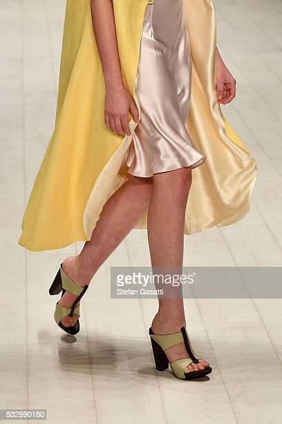 A model walks the runway in a design by Iva Pfeiffer at the Raffles International Showcase show at MercedesBenz Fashion Week Resort 17 Collections at...