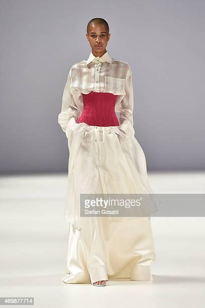 A model walks the runway in a design by Iven Teh at the Raffles International Showcase show at MercedesBenz Fashion Week Australia 2015 at...