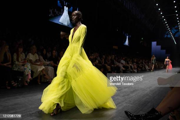 A model walks the runway in a design by Jason Grech during Runway 3 at Melbourne Fashion Festival on March 12 2020 in Melbourne Australia