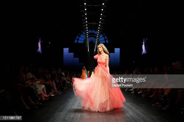 A model walks the runway in a design by JASONGRECH during Runway 3 at Melbourne Fashion Festival on March 12 2020 in Melbourne Australia