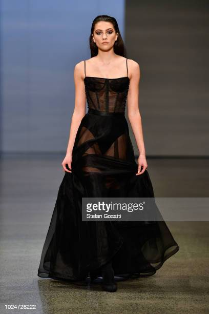 Model walks the runway in a design by Judy Gao Couture during the New Generation Emerging Couture show during New Zealand Fashion Week 2018 at...
