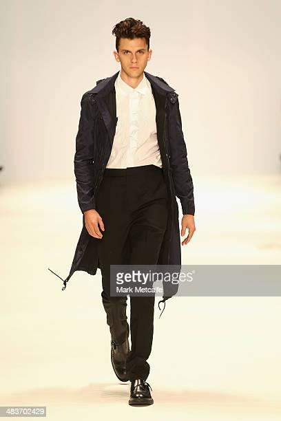 A model walks the runway in a design by Kiaya Daniels at The Innovators show during MercedesBenz Fashion Week Australia 2014 at Carriageworks on...