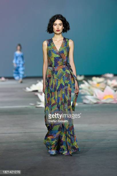 Model walks the runway in a design by Kirrikin during the Indigenous Fashion Projects show during Afterpay Australian Fashion Week 2021 Resort '22...