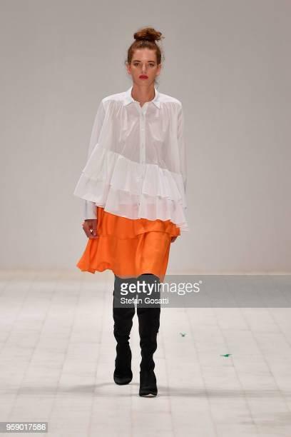 A model walks the runway in a design by Leah Williams during the Raffles International Showcase show at MercedesBenz Fashion Week Resort 19...