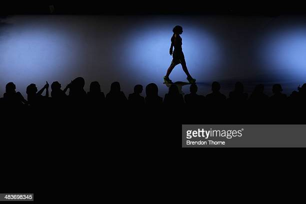 A model walks the runway in a design by Logvin Code at The Innovators show during MercedesBenz Fashion Week Australia 2014 at Carriageworks on April...