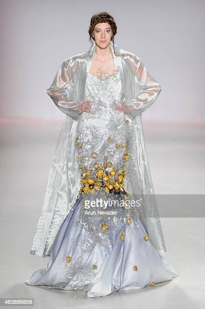 Model walks the runway in a design by Ly Qui Khanh at the New York Life fashion show during Mercedes-Benz Fashion Week Fall 2015 at The Salon at...