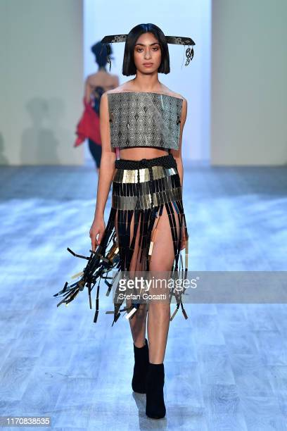A model walks the runway in a design by Nichola Te Kiri during the MIROMODA show during New Zealand Fashion Week 2019 at Auckland Town Hall on August...