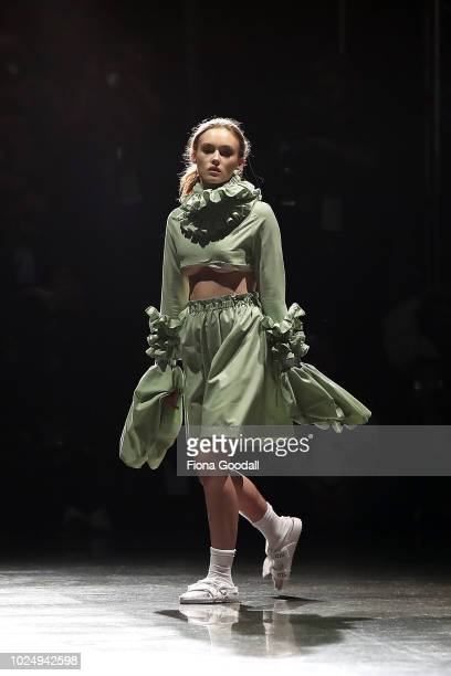 A model walks the runway in a design by Olli during the New Generation show during New Zealand Fashion Week 2018 at Viaduct Events Centreâ on August...