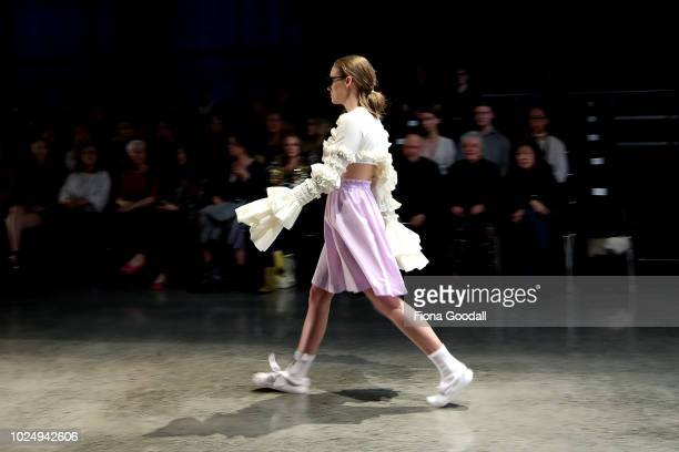 Model walks the runway in a design by Olli during the New Generation show during New Zealand Fashion Week 2018 at Viaduct Events Centreâ on August...
