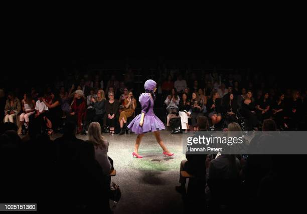A model walks the runway in a design by Resene during the Resene Designer show during New Zealand Fashion Week 2018 at Viaduct Events Centre on...