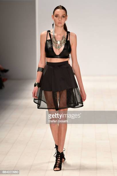 A model walks the runway in a design by Richard Giang during the The Innovators Fashion Design Studio show at MercedesBenz Fashion Week Resort 18...