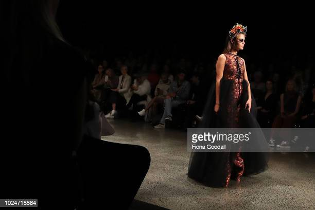 Model walks the runway in a design by Ruscoe Bustenera-Kirby during the New Generation Emerging Couture show during New Zealand Fashion Week 2018 at...