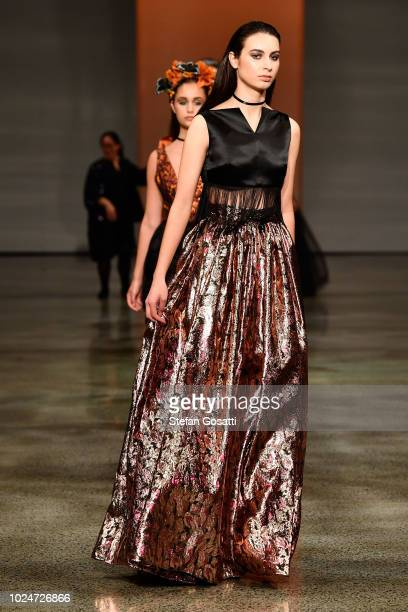 Model walks the runway in a design by Ruscoe during the New Generation Emerging Couture show during New Zealand Fashion Week 2018 at Viaduct Events...