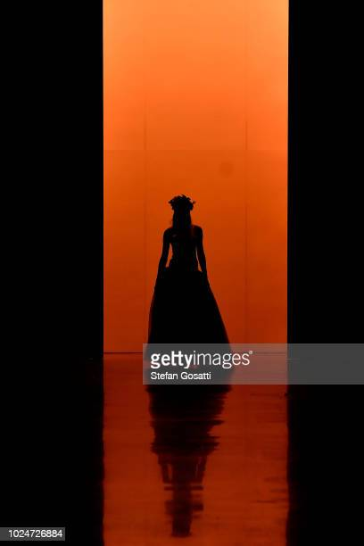A model walks the runway in a design by Ruscoe during the New Generation Emerging Couture show during New Zealand Fashion Week 2018 at Viaduct Events...