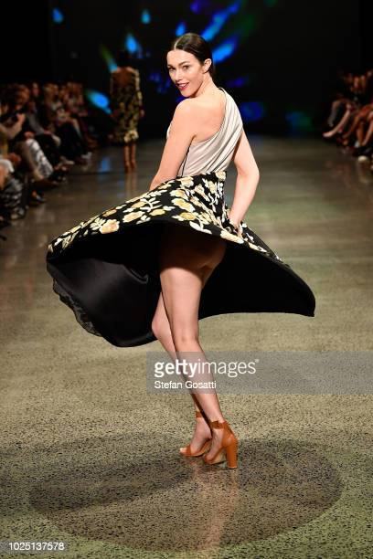 A model walks the runway in a design by Ruscoe during the Resene Designer show during New Zealand Fashion Week 2018 at Viaduct Events Centre on...