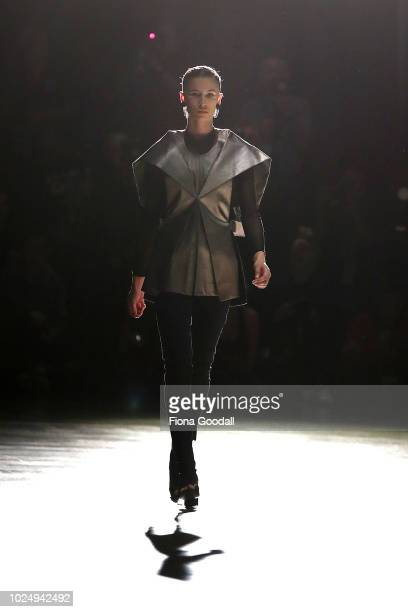 Model walks the runway in a design by Starving Artists Fund during the New Generation show during New Zealand Fashion Week 2018 at Viaduct Events...