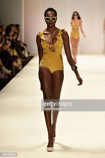 A model walks the runway in a design by Surface too Deep at the Swim show during MercedesBenz Fashion Week Australia 2014 at Carriageworks on April 8...