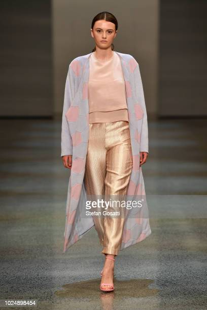 A model walks the runway in a design by Susan Colton during the NZFW The Graduate show during New Zealand Fashion Week 2018 at Viaduct Events Centre...