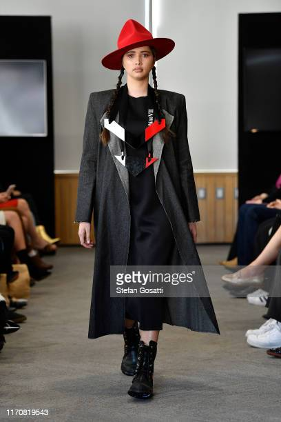 A model walks the runway in a design by Tawhaio during the AHO show during New Zealand Fashion Week 2019 at Ellen Melville Centre on August 29 2019...