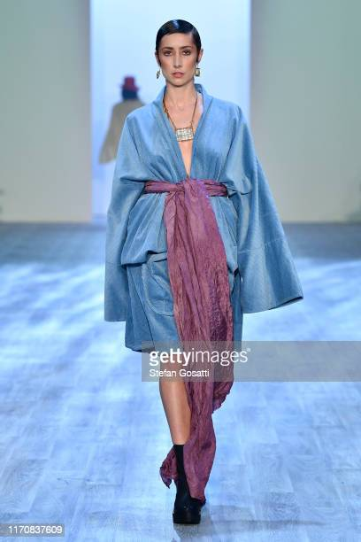 Model walks the runway in a design by Te Orihau Karaitiana during the MIROMODA show during New Zealand Fashion Week 2019 at Auckland Town Hall on...