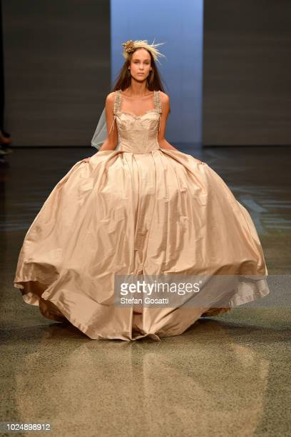 A model walks the runway in a design by Til Death Bridal during the NZFW The Graduate show during New Zealand Fashion Week 2018 at Viaduct Events...