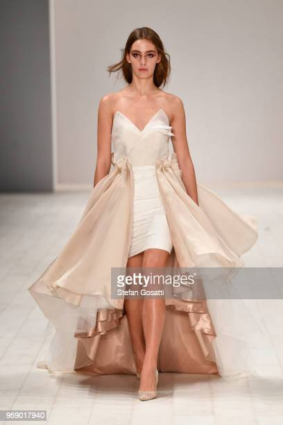 A model walks the runway in a design by VIVAN TUNG during the Raffles International Showcase show at MercedesBenz Fashion Week Resort 19 Collections...