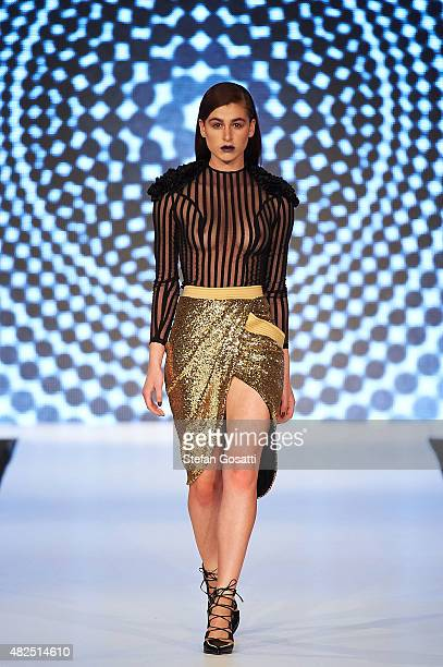 A model walks the runway in a design by Zhivago at Styleaid Go Go 2015 at Crown Perth on July 31 2015 in Perth Australia