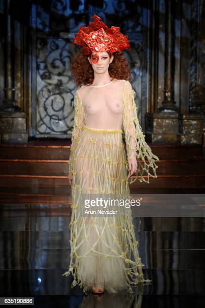 A model walks the runway in a dress entirely made of condoms designed by Julia Hursh at New York Fashion Week Art Hearts Fashion NYFW FW/17 at The...