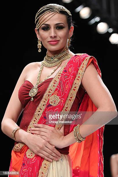 A model walks the runway in a GIA Jewellery design at the India International Jewellery Week 2012 Day 2 at the Grand Hyatt on August 20 2012 in...