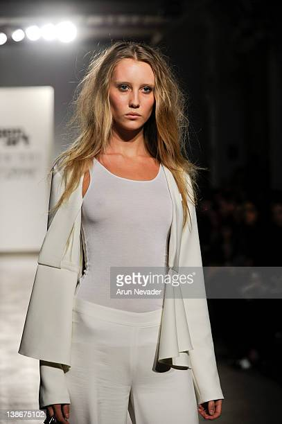 A model walks the runway in a Wen Shi design for the Gen Art New Garde Designer Competition at Exit Art on February 9 2012 in New York City