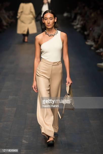 Model walks the runway in designs by Arnsdorf during Runway 1 at Melbourne Fashion Festival on March 11, 2020 in Melbourne, Australia.