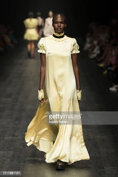 Model walks the runway in designs by macgraw during Runway 2 at Melbourne Fashion Festival on March 11, 2020 in Melbourne, Australia.