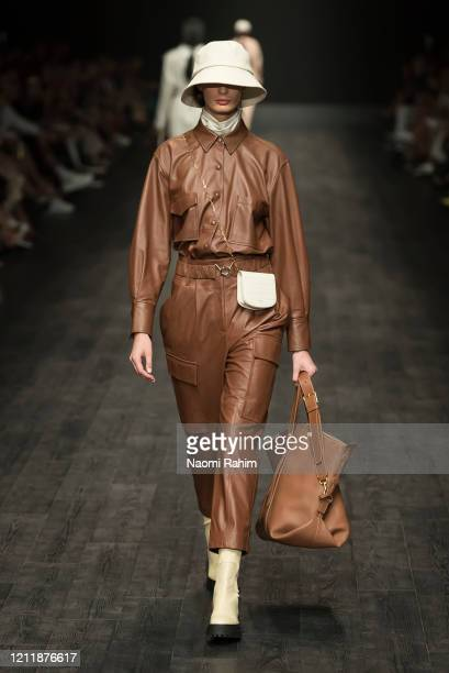 Model walks the runway in designs by OROTON during Runway 2 at Melbourne Fashion Festival on March 11, 2020 in Melbourne, Australia.