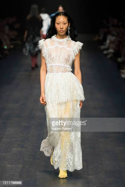 Model walks the runway in designs by Romance Was Born during Runway 1 at Melbourne Fashion Festival on March 11, 2020 in Melbourne, Australia.