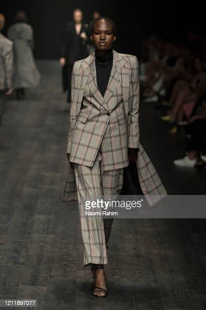 Model walks the runway in designs by STRATEAS CARLUCCI during Runway 2 at Melbourne Fashion Festival on March 11, 2020 in Melbourne, Australia.