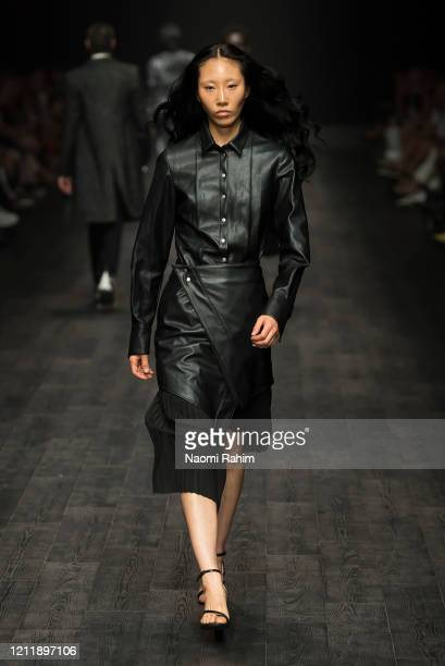 A model walks the runway in designs by STRATEAS CARLUCCI during Runway 2 at Melbourne Fashion Festival on March 11 2020 in Melbourne Australia