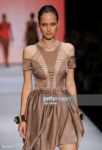 A model walks the runway in designs by Zimmermann on the catwalk at the Overseas Passenger Terminal Circular Quay on day two of Rosemount Australian...