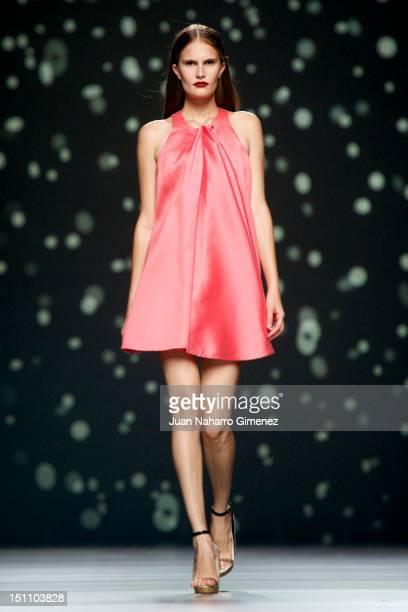 A model walks the runway in the AA de Amaya Arzuaga fashion show during the Cibeles Madrid Fashion Week Spring/Summer 2013 at Ifema on September 1...