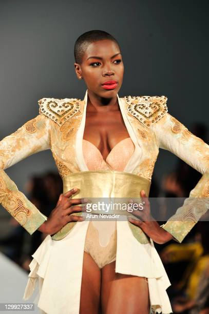 A model walks the runway in the Amato Haute Couture show during Style Fashion Week LA at Vibiana on October 21 2011 in Los Angeles California