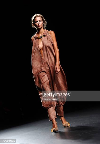 A model walks the runway in the Antonio Alvarado and Carlos Diez fashion show during the Cibeles Madrid Fashion Week Spring/Summer 2011 at the Ifema...